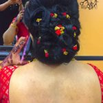 Client showing hair after receiving hairstyling service at Shamim Beauty Parlor.