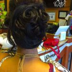 Client showing rearview of head after receiving hair updo service