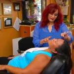 Client receiving facial threading at Shamim Beauty Parlor