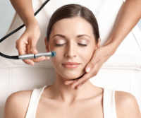 A woman receiving microdermabrasion service
