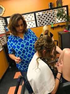 young woman receiving hair styling at a hair salon