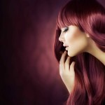 Woman with long red-dyed hair