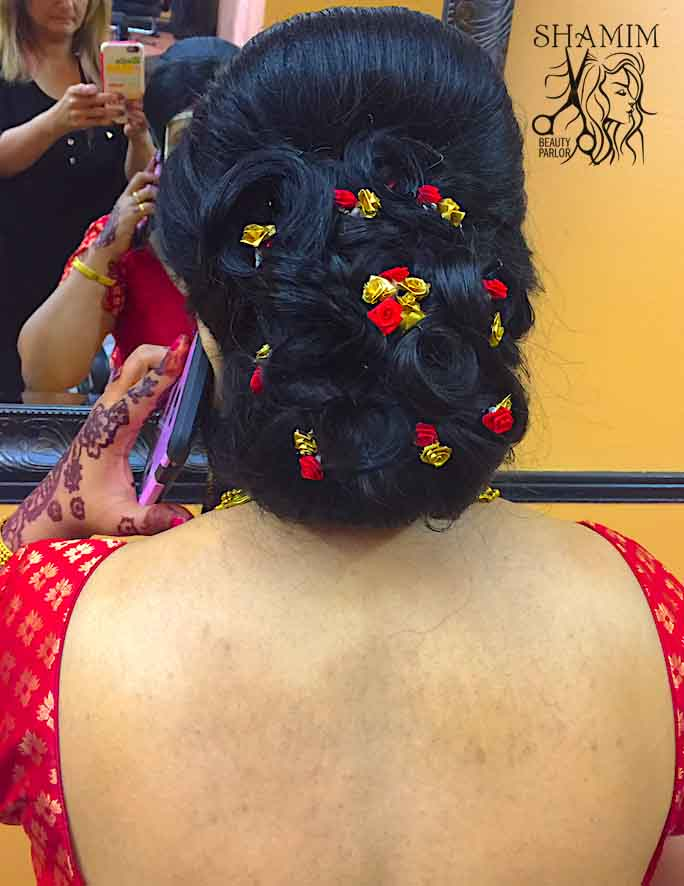 Client showing hair after receiving an updo service